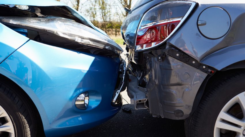 Photograph of two cars after a collision illustrating the need for car insurance.